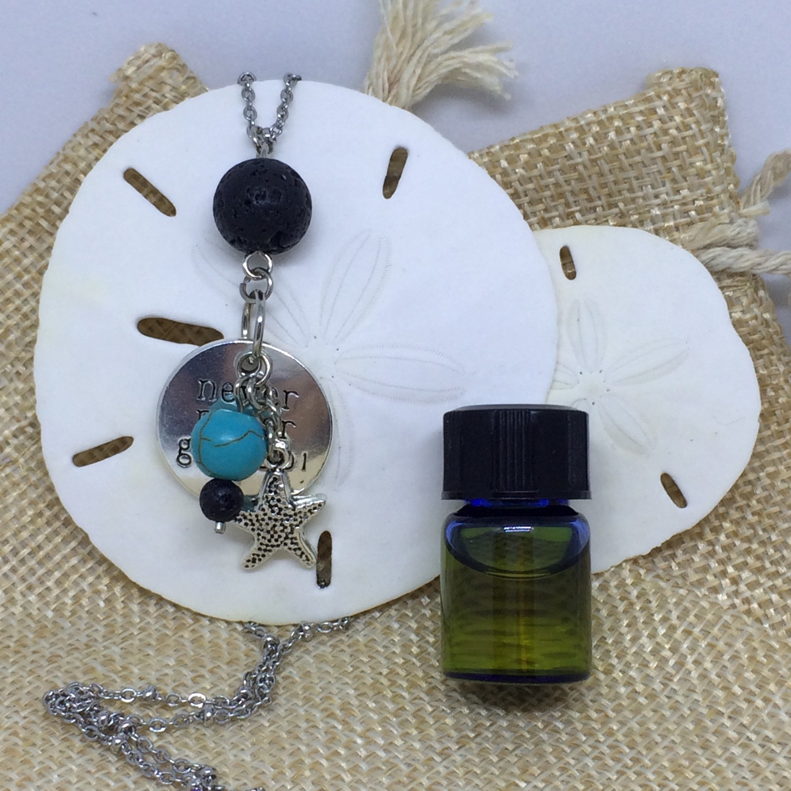 essential oils lava diffuser necklace never give up
